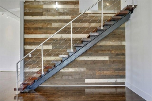 Steel and wood stair with reclaimed wood accent wall