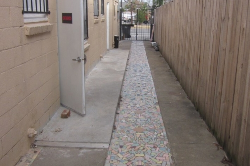 Mosaic tile walkway providing side access to St Claude Corridor Comedy Theater