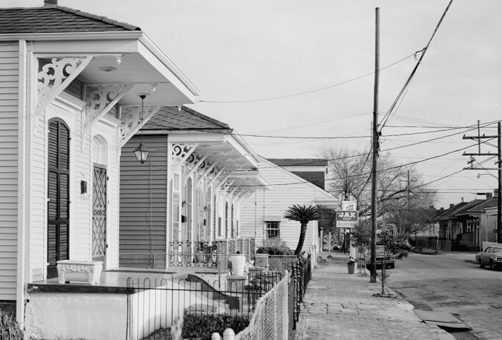Billies Bar and houses with brackets on Fourth Street